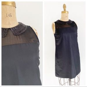 TED BAKER black mini dress with laser cut collar.